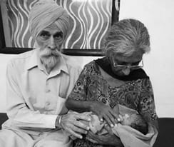 """In this undated handout photograph released by The National Fertility Centre on May 10, 2016, Indian couple Mohinder Singh Gill(L)poses with his wife Daljinder Kaur and their newly born baby at The National Fertility Centre in Hisar. An Indian woman who gave birth at the age of 70 said May 10, 2016, that she was not too old to become a first-time mother, adding that her life was now complete. Daljinder Kaur gave birth last month to a boy following two years of IVF treatment at a fertility clinic in the northern state of Haryana with her 79-year-old husband. RESTRICTED TO EDITORIAL USE - MANDATORY CREDIT """"AFP PHOTO / NATIONAL FERTILITY CENTRE"""" - NO MARKETING NO ADVERTISING CAMPAIGNS - DISTRIBUTED AS A SERVICE TO CLIENTS - RESTRICTED TO EDITORIAL USE - MANDATORY CREDIT """"AFP PHOTO / NATIONAL FERTILITY CENTRE"""" - NO MARKETING NO ADVERTISING CAMPAIGNS - DISTRIBUTED AS A SERVICE TO CLIENTS / AFP / NATIONAL FERTILITY CENTRE / HO / RESTRICTED TO EDITORIAL USE - MANDATORY CREDIT """"AFP PHOTO / NATIONAL FERTILI"""