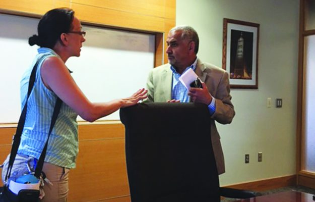 Laura Manriquez, candidate for 8th Assembly District, speaking with Ghassan A. Korban, Commissioner of the City of Milwaukee Department of Public Works, addressing removal of 70,000 lead service lines in Milwaukee.