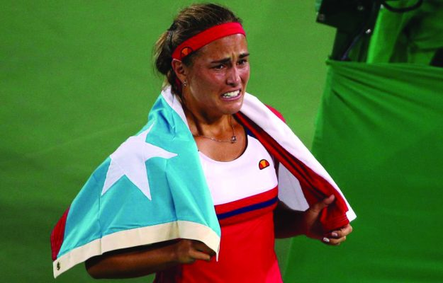 2016 Rio Olympics - Tennis - Final - Women's Singles Gold Medal Match - Olympic Tennis Centre - Rio de Janeiro, Brazil - 13/08/2016. Monica Puig (PUR) of Puerto Rico celebrates after winning match against Angelique Kerber (GER) of Germany.       REUTERS/Kevin Lamarque FOR EDITORIAL USE ONLY. NOT FOR SALE FOR MARKETING OR ADVERTISING CAMPAIGNS.