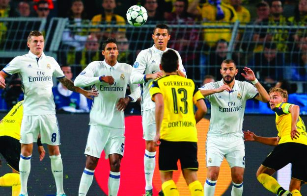Real Madrid's Cristiano Ronaldo jumps next to Raphael Varane and Karim Benzema during the Champions League group F soccer match between Borussia Dortmund and Real Madrid in Dortmund, Germany, Tuesday, Sept. 27, 2016. (AP Photo/Michael Probst)